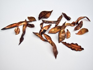 Small hand forged copper leaves